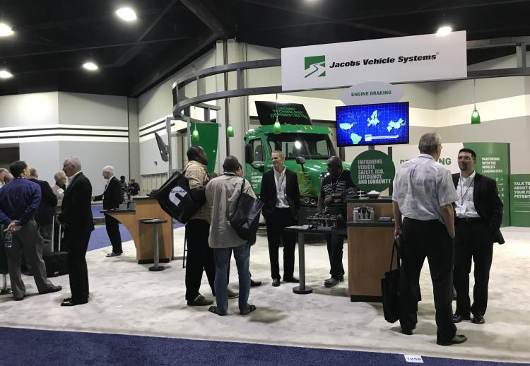 Image of Jacobs 2017 NACV Booth with Jacobs representatives speaking to customers in the booth.